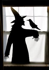 birshykat witch with caldron window silhouette