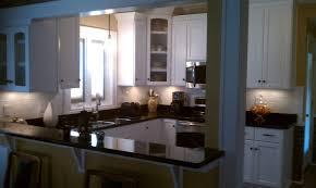 with peninsula black kitchen cabinets u shaped kitchen glass