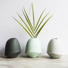 we love the unique shape of these ceramic bud vases from bean