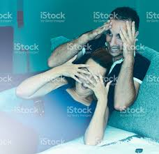couple watching scary horror halloween movie scene stock photo