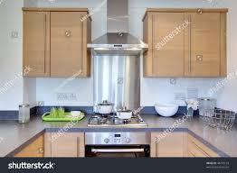 chic modern kitchen oak cupboards fitted stock photo 48775159