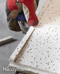 Installing Ceiling Tiles by Drop Ceiling Installation Tips Family Handyman