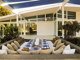 outdoor dining rooms this outdoor dining room has plenty of seating for large gatherings