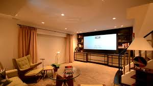 media room with motorized projector lift motorized screen