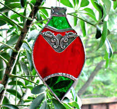holiday ornament in stained glass red christmas holiday