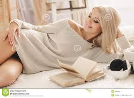woman reading a book lying on the sofa stock photo image 48850271