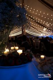 Canopy Tent Wedding by A String Light Canopy Provides Soft Warm Light For A Tent Wedding