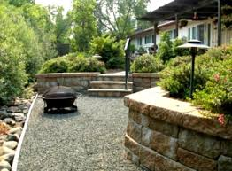 Affordable Backyard Patio Ideas by Outdoor Concrete Deck With Stone Fire Pit For Inexpensive Small