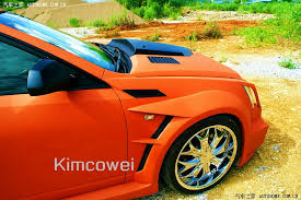 kits for cadillac cts matte orange cadillac cts gets kit of questionable taste in