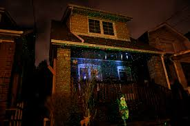 christmas projection lights projection spotlights sweeping suburbia ahead of the holidays