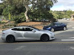 tesla model 3 release candidate spotted next to a model s prompts