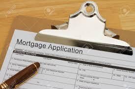 bureau des hypoth鑷ue formulaire de demande d hypothèque sur un presse papiers avec un