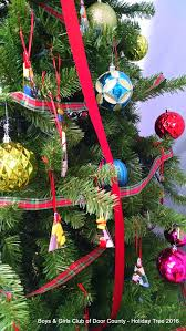 tree festooned with glass ornaments for sale