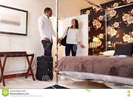 Young Couple Room A Young Multi Ethnic Couple Arriving At Their Hotel Room Stock