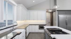 painting stained wood kitchen cabinets should you stain or paint your kitchen cabinets for a change
