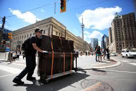 muscular busker sebastian brown pushes a piano two kilometres to