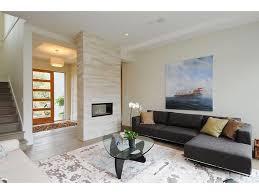 modern glass fireplace doors glass front door beige tile fireplace large artwork light wood