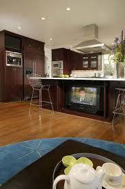 marble countertops dark kitchen cabinets with floors lighting
