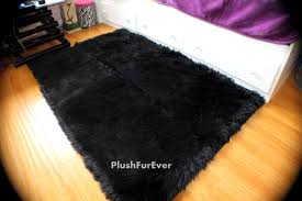 Dark Rug Bedroom Cozy Pergo Flooring With Dark Faux Sheepskin Rug