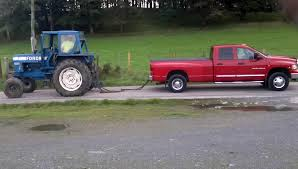 dodge vs ram ford 8600 tractor goes toe to toe with a dodge ram 3500 big
