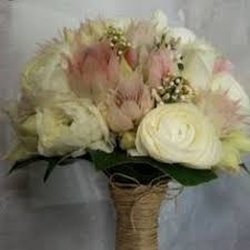 wedding flowers quote form bridal bouquet of peonies freesias sweetpeas and roses rosehip