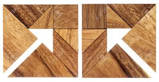 two abstract pictures of an arrow built from seven tangram wooden