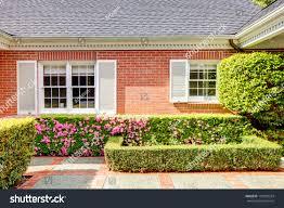 brick red house english garden white stock photo 135893324