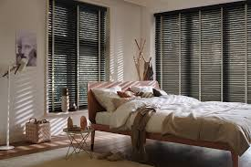 bedroom decorating ideas for summer get the bones right a wall colour that can be styled differently like a warm grey or classic navy dark wood or white shutters at the window and lighting