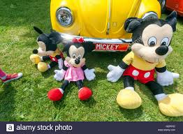 yellow volkswagen beetle royalty free yellow vw beetle and mickey mouse family stock photo royalty free