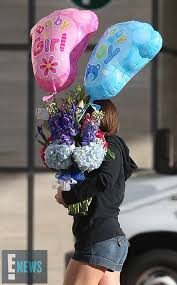 hospital balloon delivery beyoncé baby gift woman carries curious package at hospital as