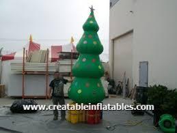 snowman up tree santa
