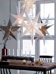 Window Christmas Decorations by Idea For Our Gold Stars Hang Them From The Light Fixture Over The