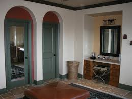 color playing with color in this spanish style master bathroom