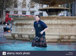 tartan vs plaid scotland fans wearing kilts in joyous mood drinking and singing