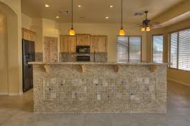 country kitchen with complex granite counters u0026 ceiling fan in