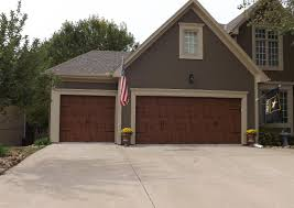 3 car garage door clopay gallery garage door ultra grain dark oak wrought iron