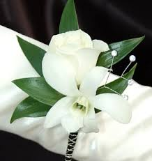 white orchid corsage white sweetheart and white orchid boutonniere black