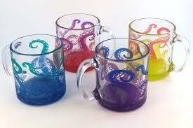 colorful handmade coffee mugs featuring etched and painted