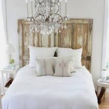 Bedroom Chandelier Ideas Decorating White Bedroom With Black Trunk And Blanket And Striped
