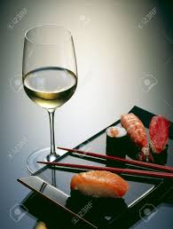 sushi with chopsticks and a glass of wine stock photo picture