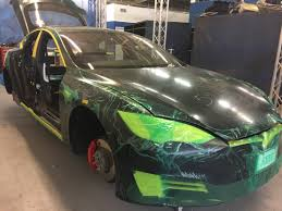 armormax fortifies tesla model s p100d with bulletproof glass and
