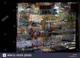 murano glass ornaments in souvenir shop window venice italy