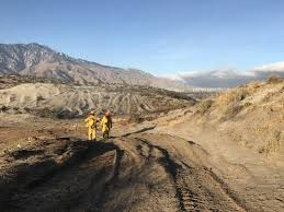 best target for black friday palm springs wind fans debris fire burning for a week in desert springs