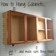 installing cabinets in kitchen how to hang cabinets and make sure they stick calgar gabinetes