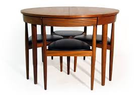 compact dining table and chairs all tucked in hans olsens super space saving dining set dining