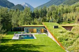 sustainable home with 2 landscaped roofs conceals private terrace