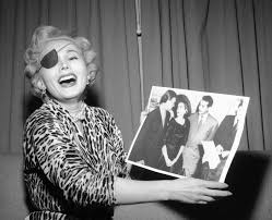 zsa zsa gabor laughing and wearing eye patch