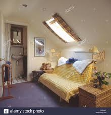 Bathroom In Loft Conversion Yellow Checked Throw On Futon Sofabed In Loft Conversion Bed