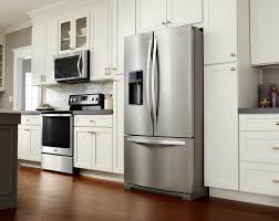 white kitchen cabinets and black stainless steel appliances white vs black vs stainless steel appliances
