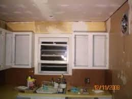 Painting Over Laminate Cabinets Refinishing Laminate Cabinets Thriftyfun